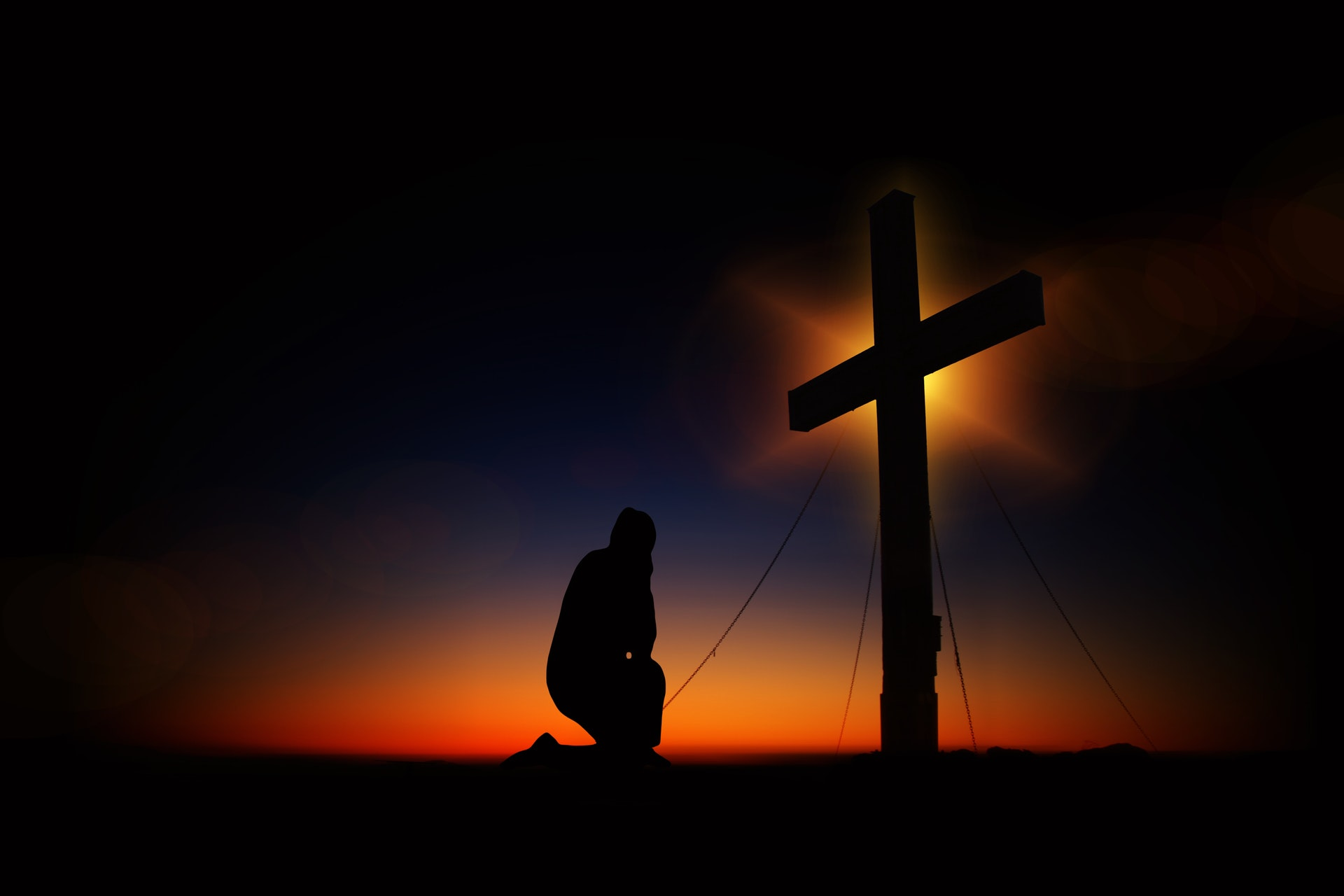 kneeling in prayer at cross with prayer music and meditation